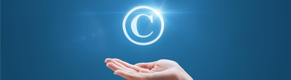Copyright icon on hand for UNE standards